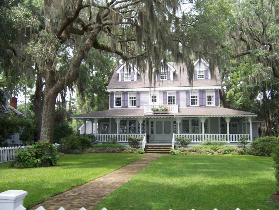 Many of the homes along the waterfront are nestled inside big oak trees with hanging moss.