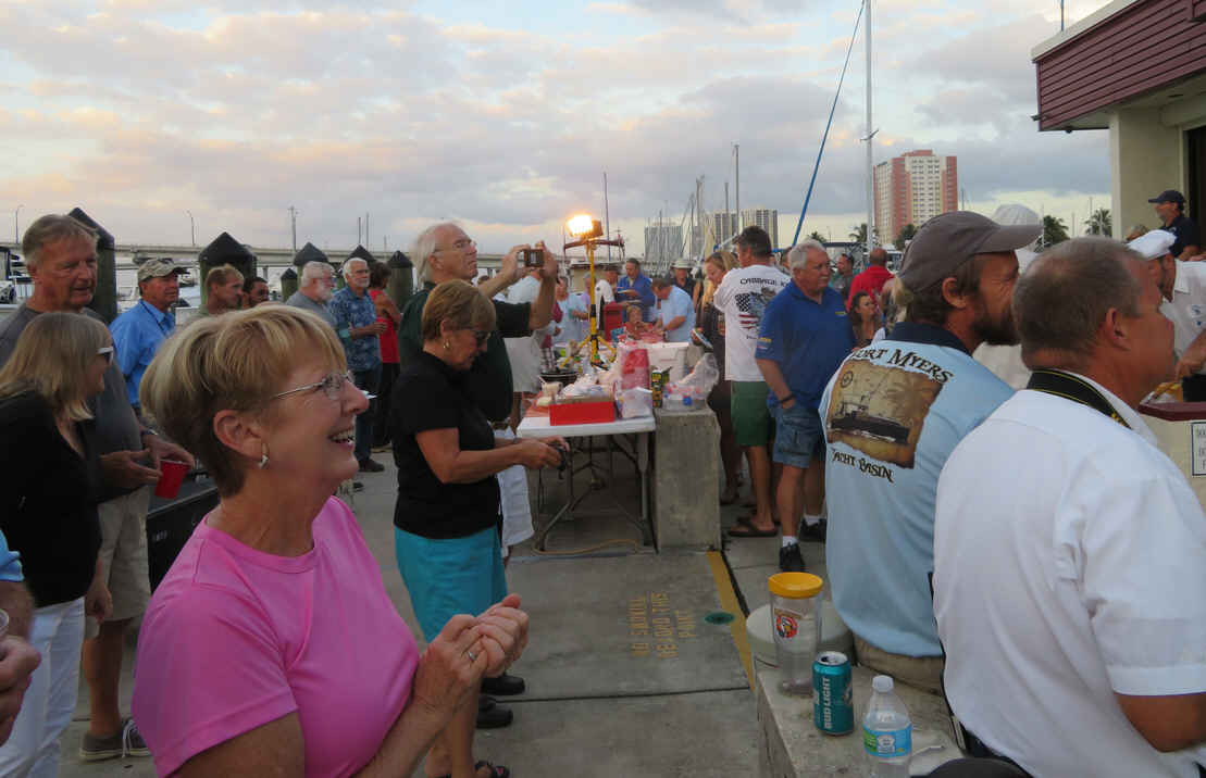 "Great turn-out at the dock party. That's Jane off ""Rising Tide"" enjoying the event. We all brought dishes to share and the marina grilled steaks, burgers and hot dogs."
